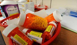 Pill bottles in basket