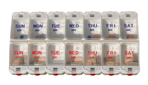 Pills in a dispenser box marked with days of week